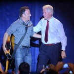 Former president Bill Clinton greets rock singer/songwriter Bruce Springsteen at a campaign rally for President Obama on Oct. 18, 2012 in Parma, OH. AP Photo/Tony Dejak