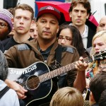 Rock guitarist Tom Morello gathered amongst thousands of protesters at a NYC rally for Occupy Wall Street.