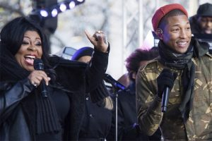 Burell performing with Pharrell Williams