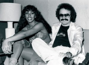 Giorgio Moroder seated with Donna Summer, circa 1977