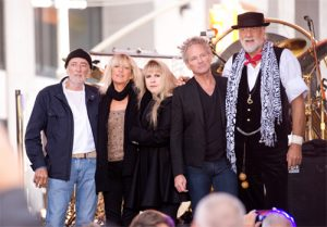 Fleetwood Mac posing with Lindsey Buckingham in 2017 at MusiCares benefit.
