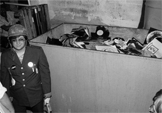 Steve Dahl, photographed in front of bin of records. One of the identified records on the very far right is Gladys Knight & the Pips' Imagination, a R&B record released in 1973.